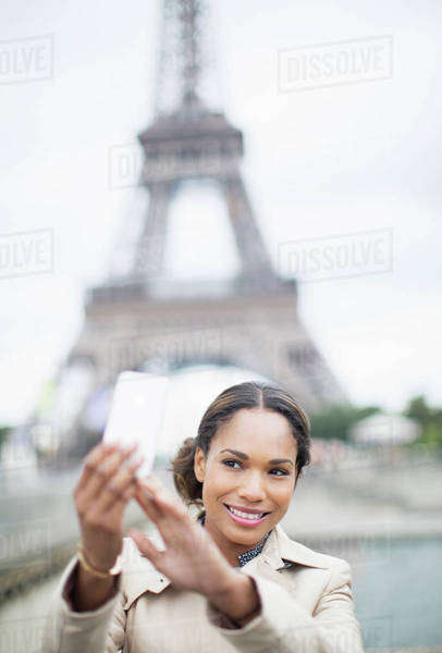 Woman taking self-portrait in front of Eiffel Tower, Paris, France Royalty-free stock photo
