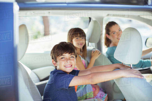 Portrait of happy family inside of car Royalty-free stock photo