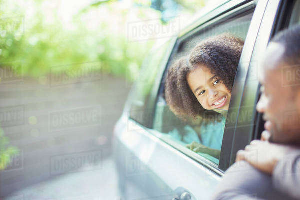 Father and daughter leaning out car windows Royalty-free stock photo