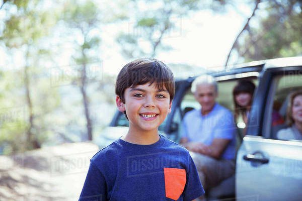 Portrait of smiling boy outside car Royalty-free stock photo