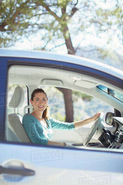 Portrait of smiling woman inside car Royalty-free stock photo