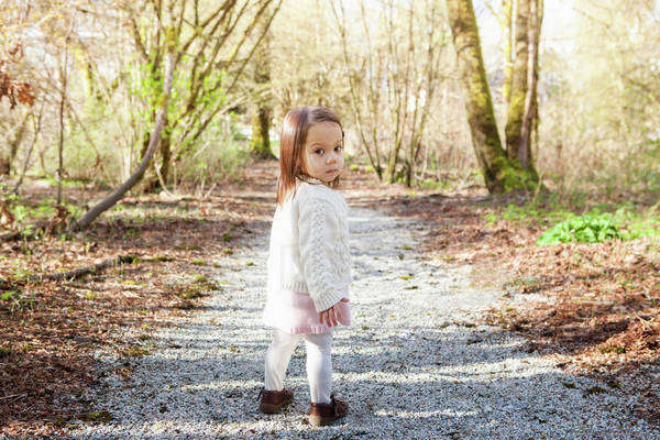 Baby girl walking on gravel path Royalty-free stock photo