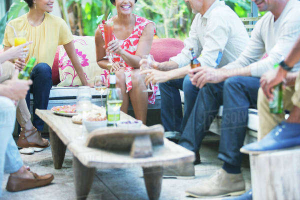 Friends relaxing together at party Royalty-free stock photo