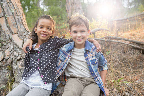 Children sitting together outdoors Royalty-free stock photo