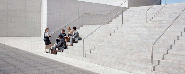 Business people meeting on concrete steps Royalty-free stock photo