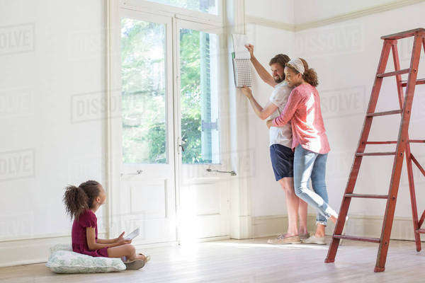 Family fixing up new home together  Royalty-free stock photo