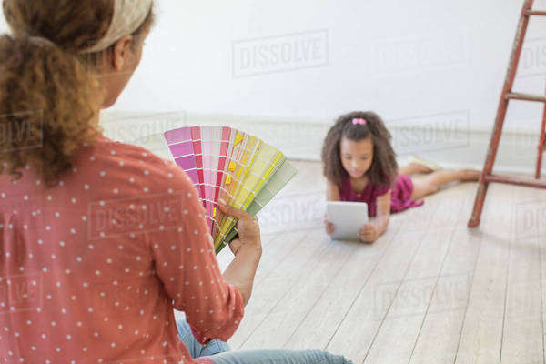 Woman looking through color swatches  Royalty-free stock photo