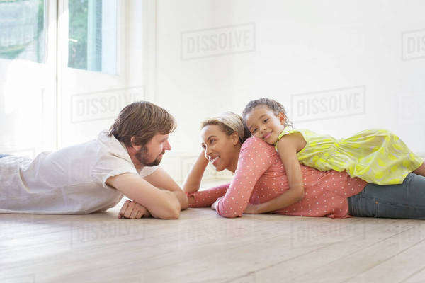 Family laying on the ground together in living space  Royalty-free stock photo