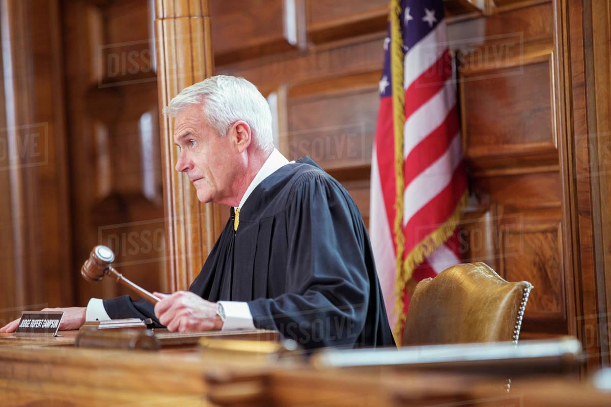 judge banging gavel in court stock photo dissolve