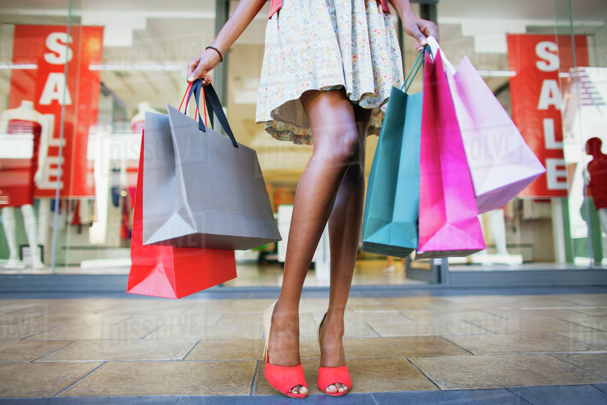 Woman Carrying Shopping Bags In Shopping Mall Stock Photo Dissolve