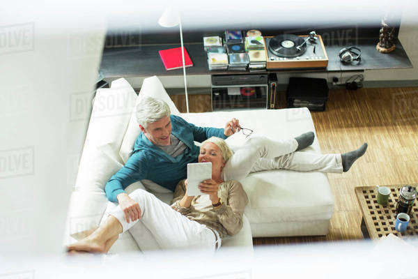 High angle view of older couple using digital tablet on sofa Royalty-free stock photo
