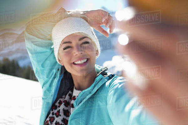 Happy woman taking selfie in snow Royalty-free stock photo