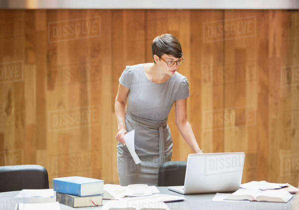Businesswoman working at laptop in office Royalty-free stock photo