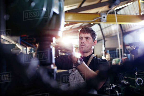 Focused mechanic working in auto repair shop Royalty-free stock photo