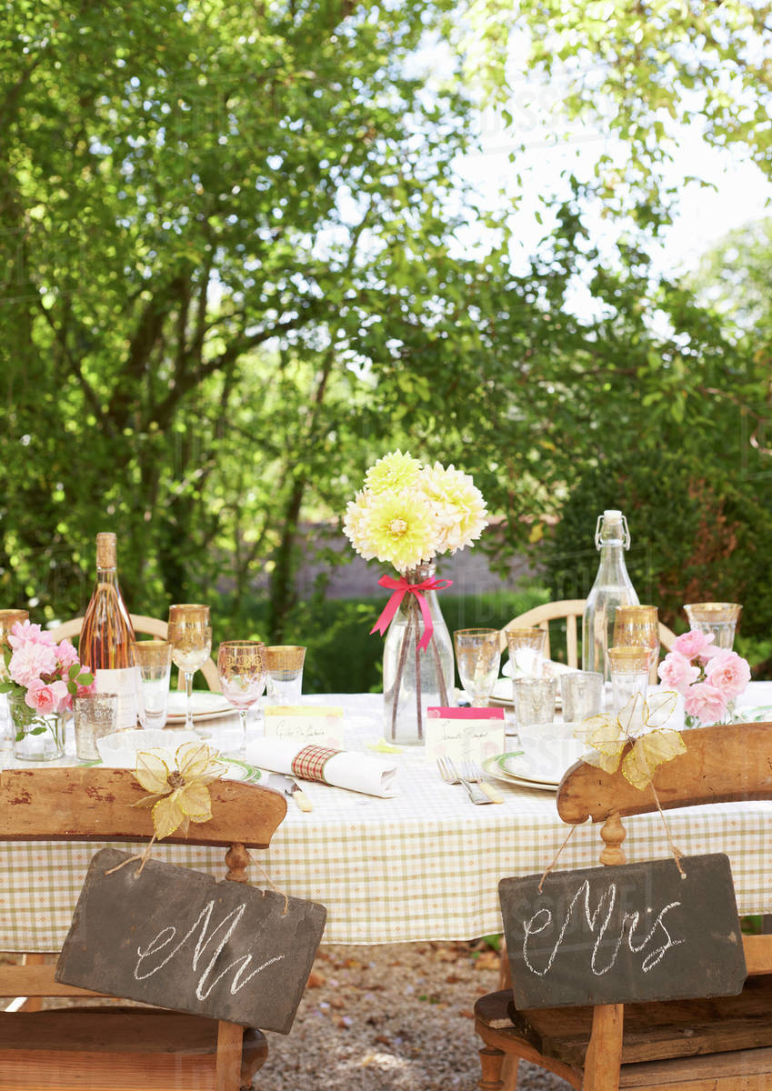 Table setting for outdoor wedding reception & Table setting for outdoor wedding reception stock photo