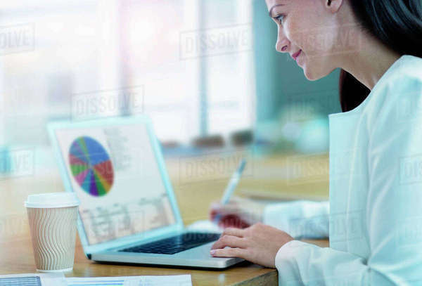 Businesswoman working at laptop Royalty-free stock photo