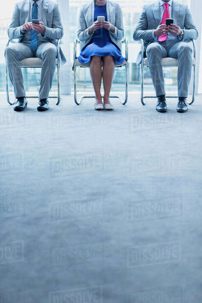 Business people with cell phones waiting in a row Royalty-free stock photo