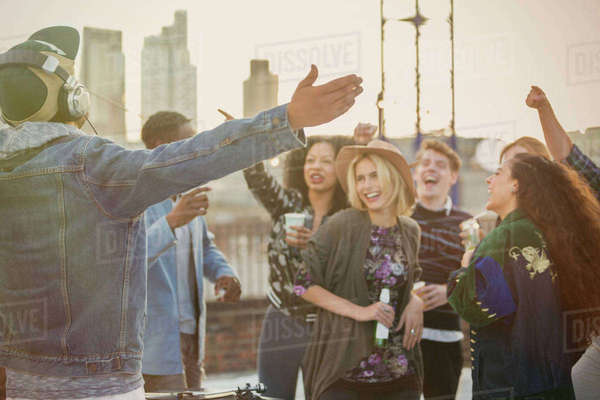 Crowd cheering for DJ at rooftop party Royalty-free stock photo