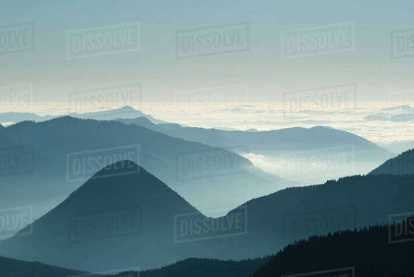 Aerial view of mountaintops over clouds Royalty-free stock photo