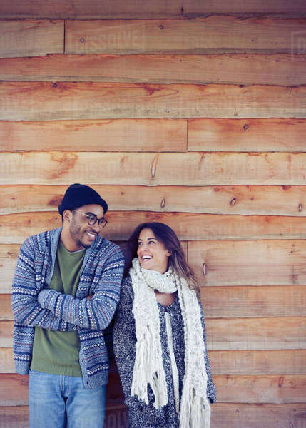 Smiling couple outside cabin Royalty-free stock photo