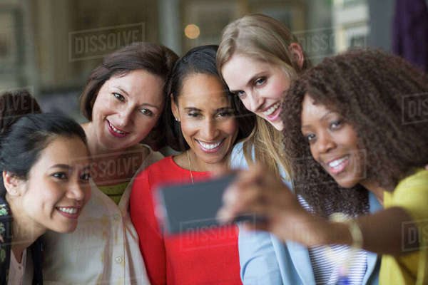 Women friends taking selfie with camera phone Royalty-free stock photo