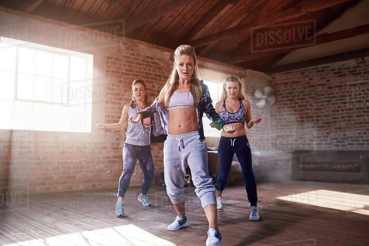 portrait young female hip hop dancers dancing in studio stock