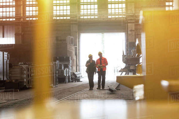 Steel workers walking in factory Royalty-free stock photo