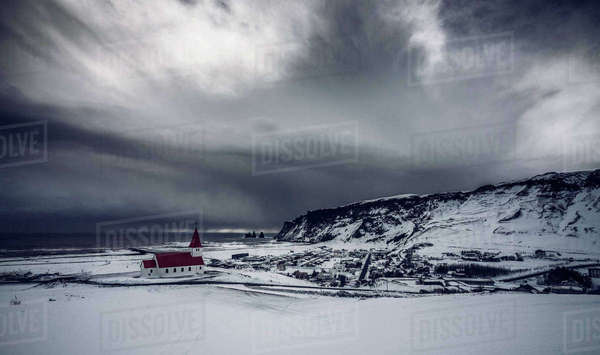 Church in remote snow covered landscape below stormy sky, Vik, Iceland Royalty-free stock photo