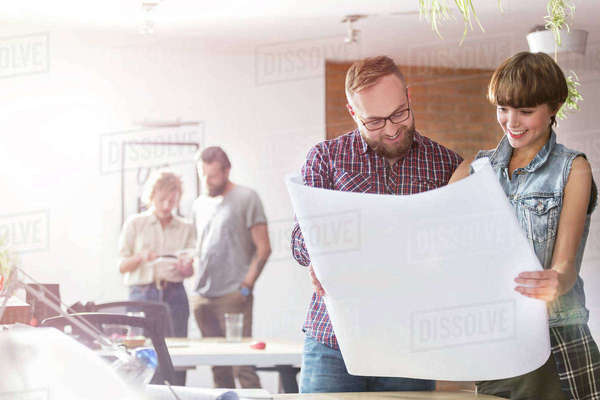 Design professionals reviewing blueprints in office Royalty-free stock photo