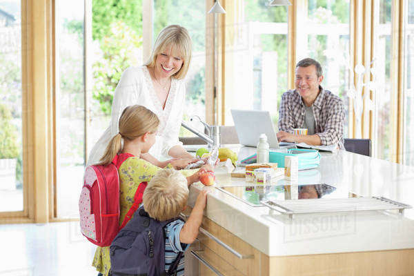 Family talking in kitchen Royalty-free stock photo