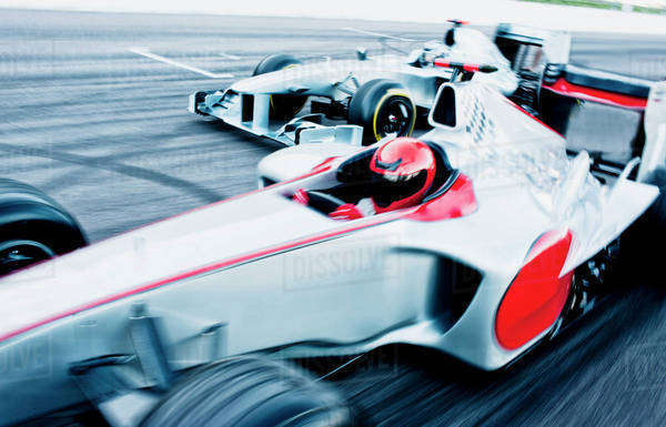 Race cars driving on track Royalty-free stock photo