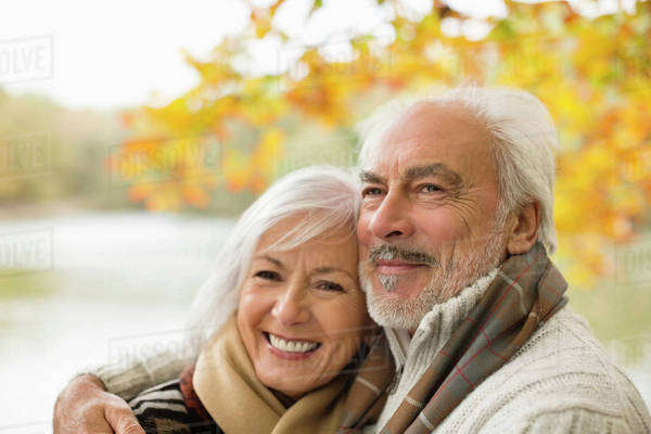 Older couple hugging in park Royalty-free stock photo