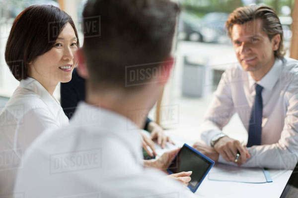 Business people with digital tablet talking in meeting Royalty-free stock photo