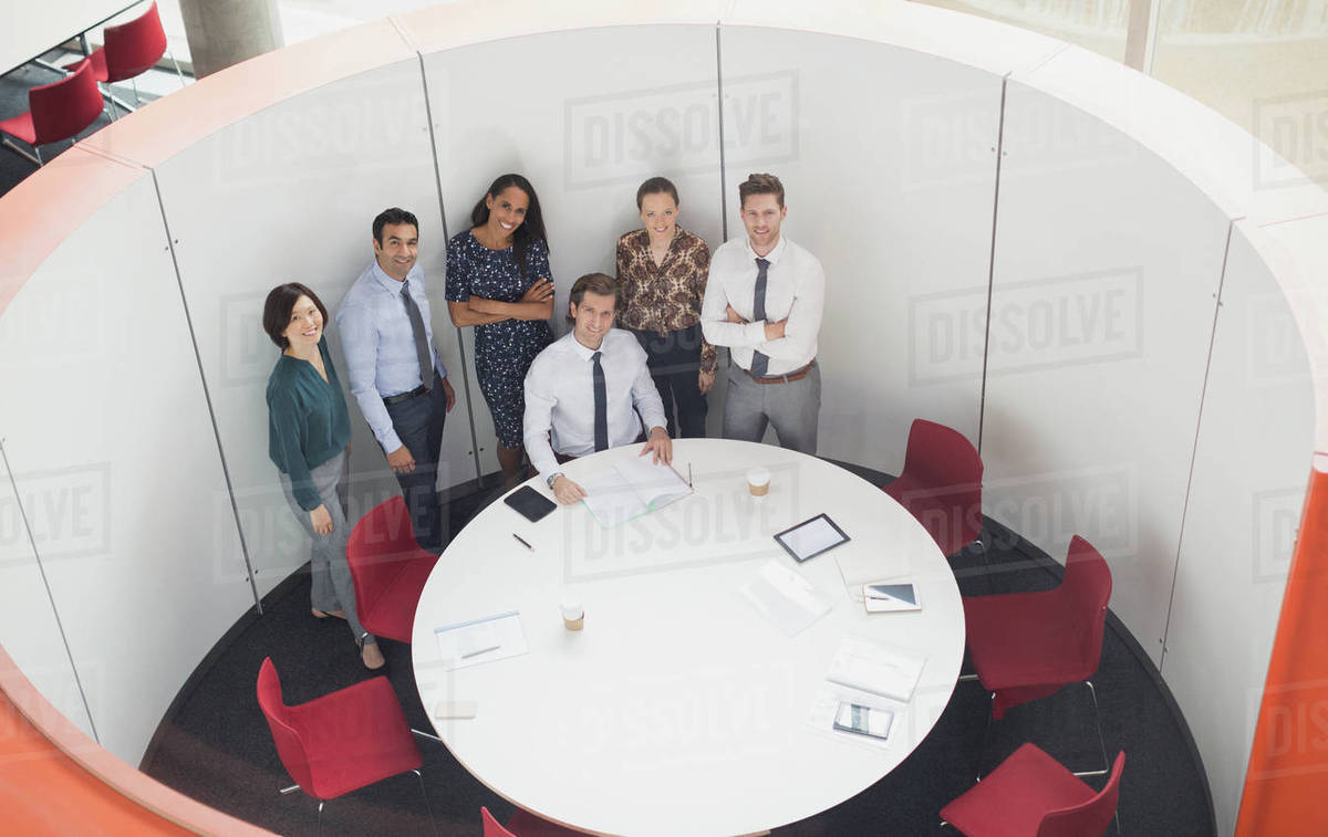 Portrait Smiling Business People Meeting At Round Table Conference Room