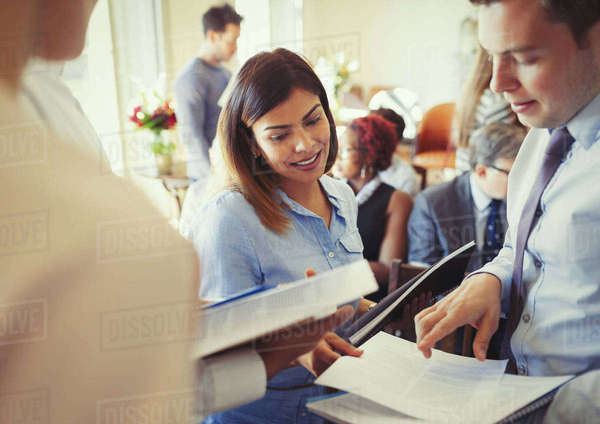 Business people discussing paperwork at business conference Royalty-free stock photo