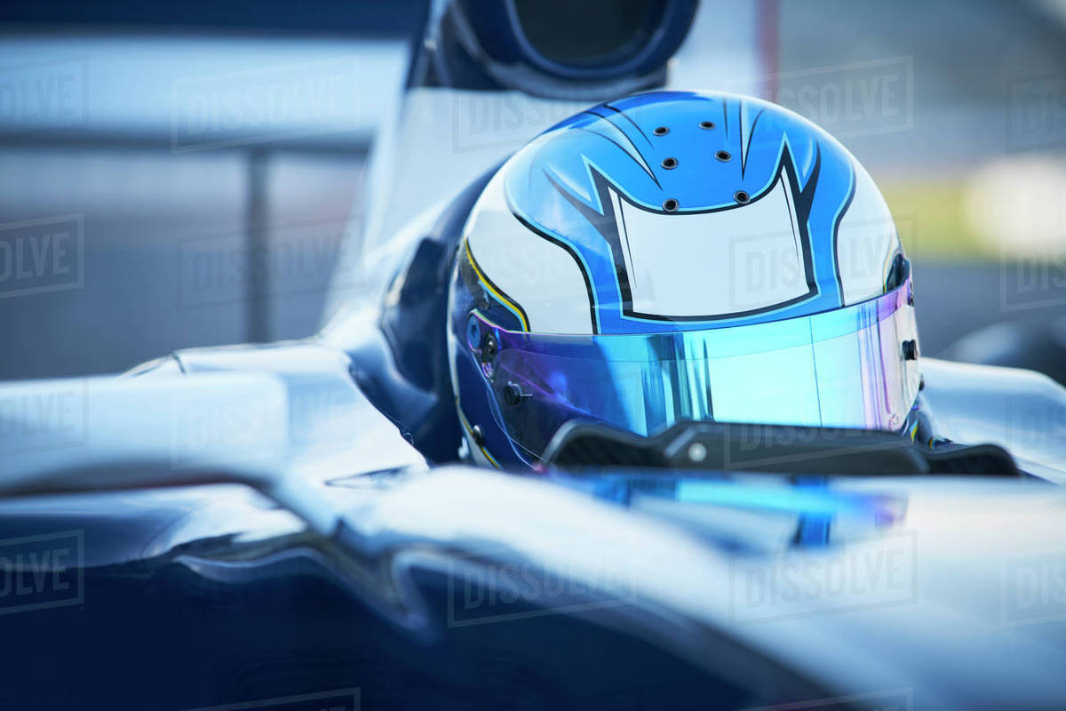 Close up formula one race car driver wearing blue helmet Royalty-free stock photo