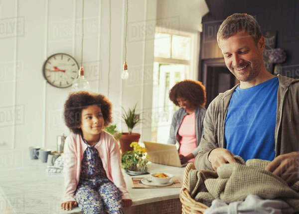 Multi-ethnic young family in kitchen Royalty-free stock photo