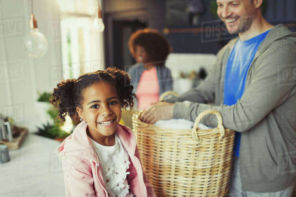 Portrait smiling daughter with father in kitchen Royalty-free stock photo