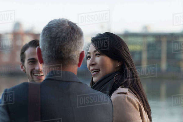 Business people talking outdoors Royalty-free stock photo