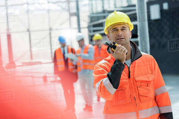 Male foreman using walkie-talkie at construction site Royalty-free stock photo