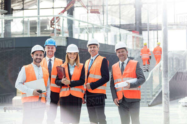 Portrait confident engineers and architects at construction site Royalty-free stock photo