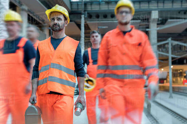 Construction workers leaving for lunch at construction site Royalty-free stock photo