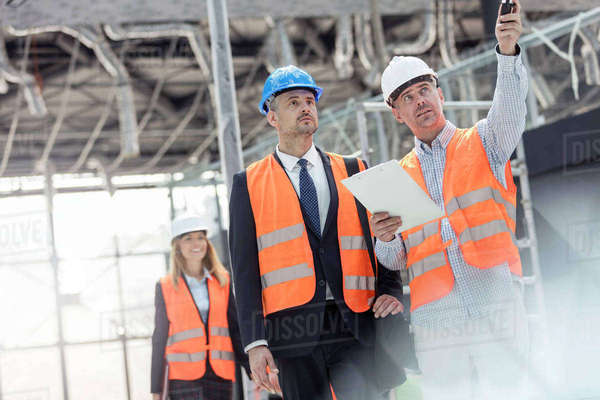 Businessman and engineer talking at construction site Royalty-free stock photo