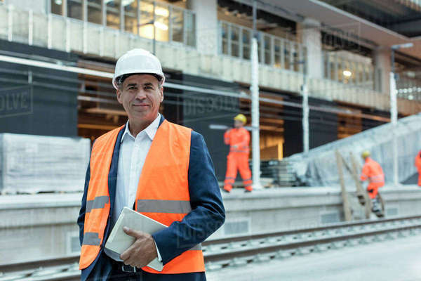 Portrait confident engineer with digital tablet at construction site Royalty-free stock photo