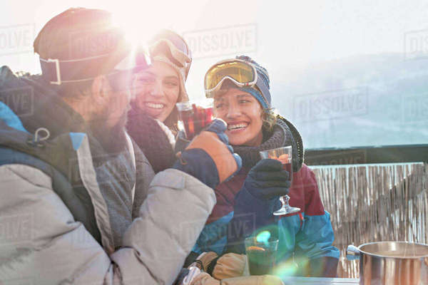Smiling skier friends drinking cocktails apres-ski Royalty-free stock photo