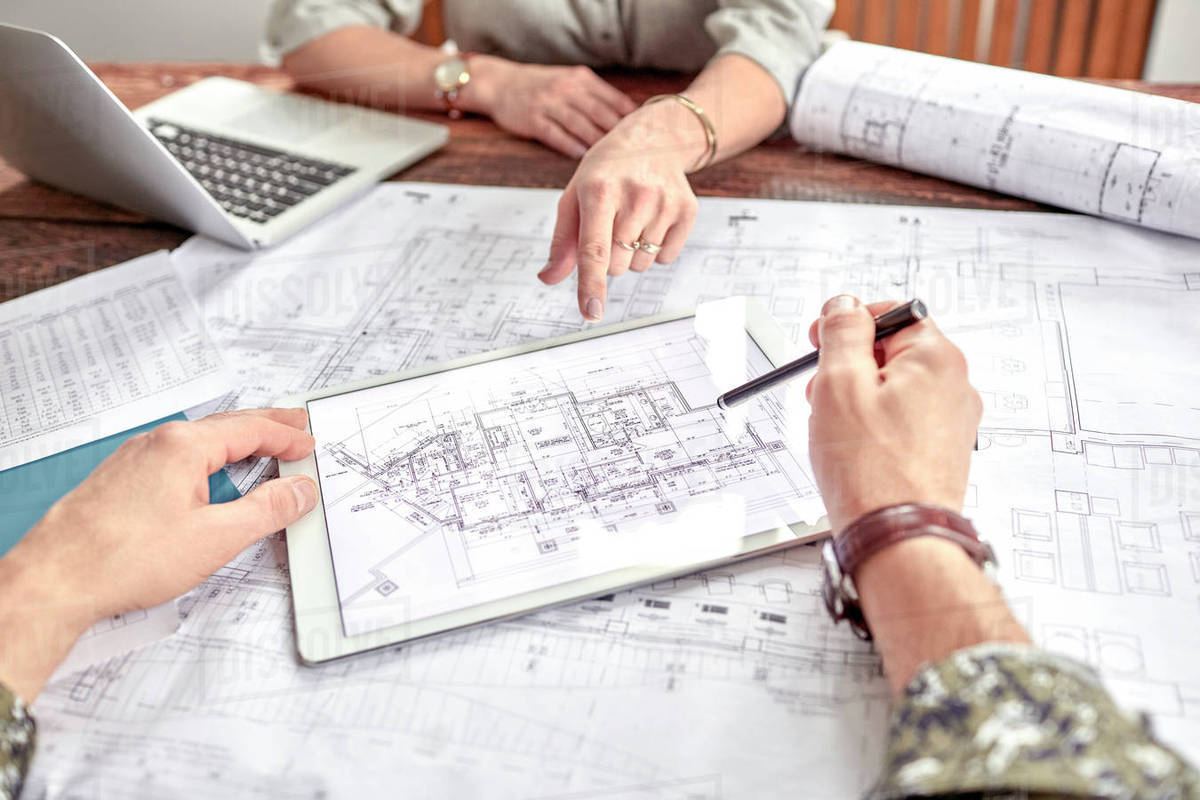 Architects reviewing and discussing complex digital blueprint in architects reviewing and discussing complex digital blueprint in meeting malvernweather Images