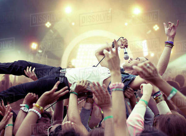 Performer crowd surfing at music festival Royalty-free stock photo