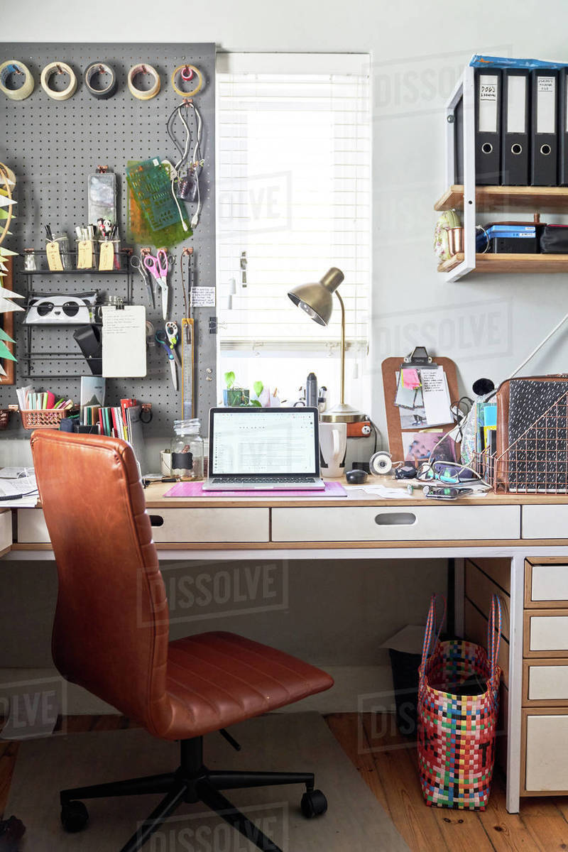 Laptop on desk in creative home office Royalty-free stock photo