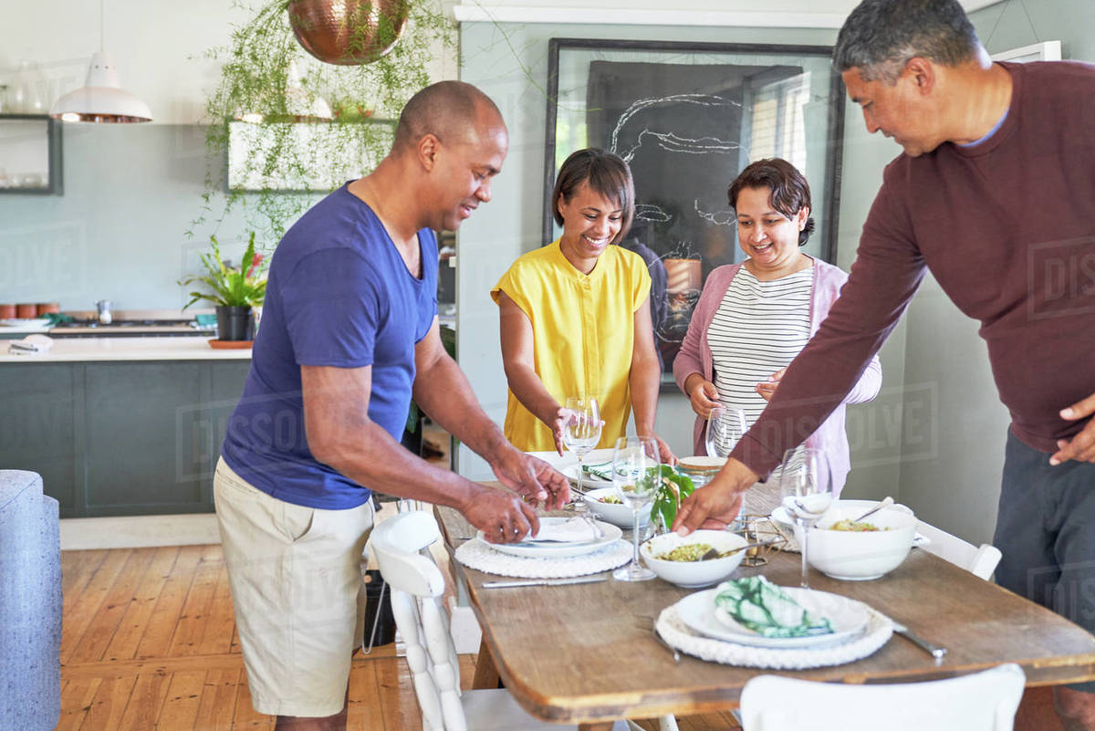 Mature couple friends setting the table for lunch Royalty-free stock photo