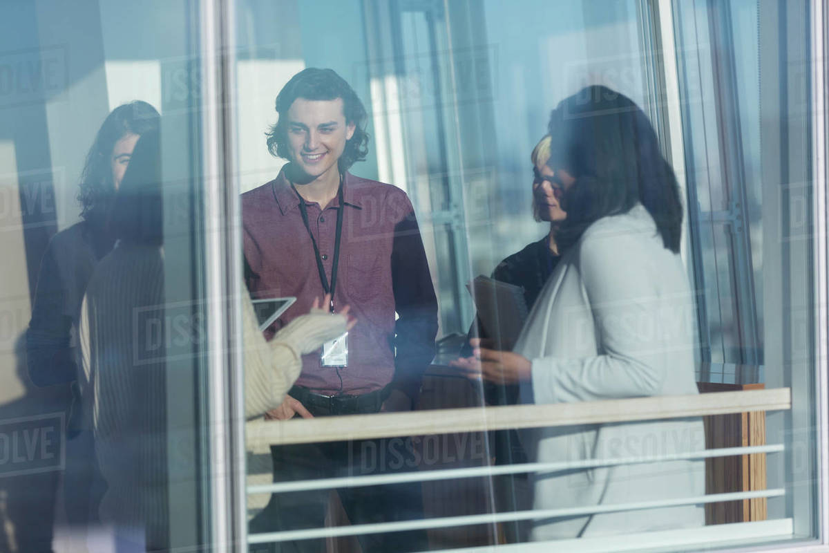 Business people talking in sunny window Royalty-free stock photo